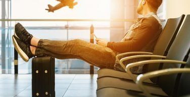 A traveller relaxing in the airport