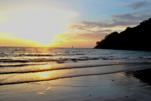 The sun setting over a beach in Indonesia