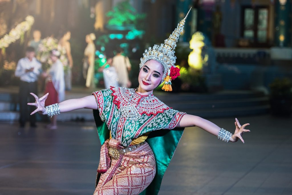 A woman dancing in classical Thai dress