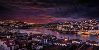 Dusk and the river Duoro flowing through Porto